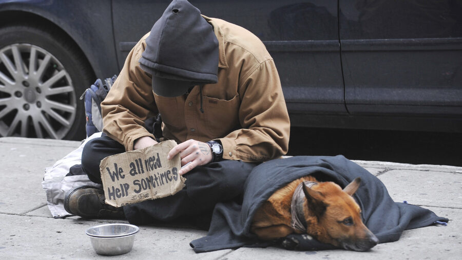 A homeless man sits with his dog on a street in Montreal, Tuesday, December 2, 2008. THE CANADIAN PRESS IMAGES/Graham Hughes